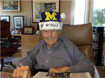 Dr. Beyster wearing a University of Michigan Santa hat